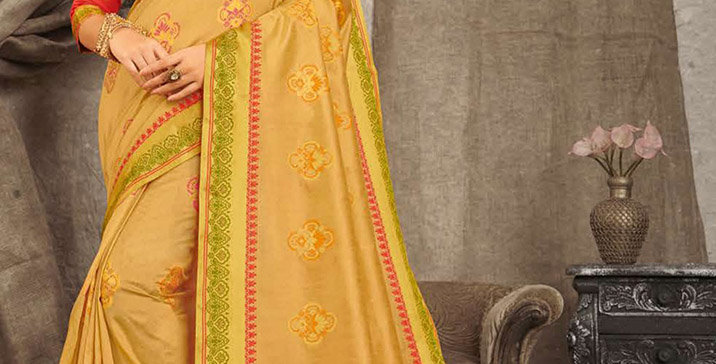 A Pretty Traditional Look  Beige Color Paired With Red Colored blouse