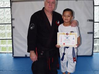 Dayton Winiata grades to blue belt