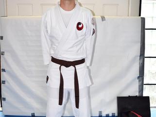 Lyndon Moore grades to Brown belt black stripe