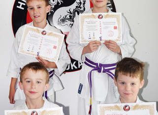 Johnson family grade to purple belt
