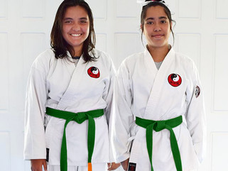 Isobelle and Jordan earn orange Aiki tabs