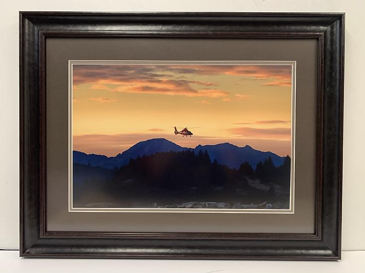 USCG Dolphin flying over Kodiak by Risha Isom