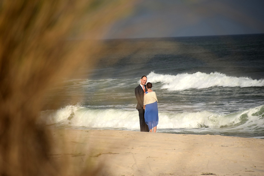 Bride and groom alone on a beach