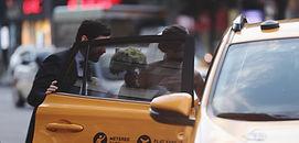 Bride an Groom make an escape in a NYC Taxi
