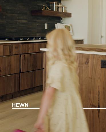 Hewn line-Girl Walking Through Kitchen.jpg