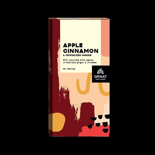 אריזה מלבנית בצבעי בורדו וורוד עם טבלת שוקולד חלב בתוספת תפוח, ג'ינג'ר וקינמון