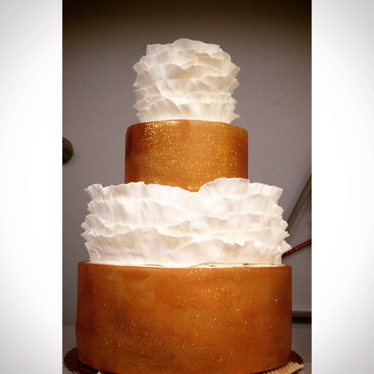 Gold and ruffles fondant wedding cake cincinnati