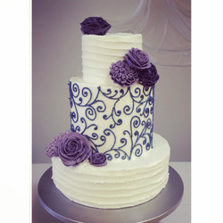 purple flowers and scrollwork cincinnati wedding cake