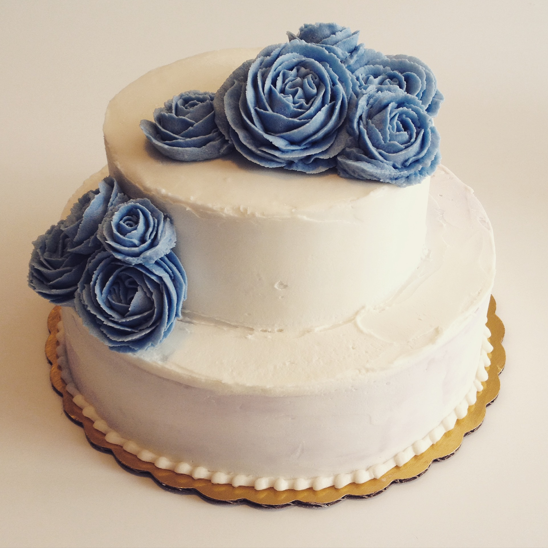 blue buttercream rose wedding cake