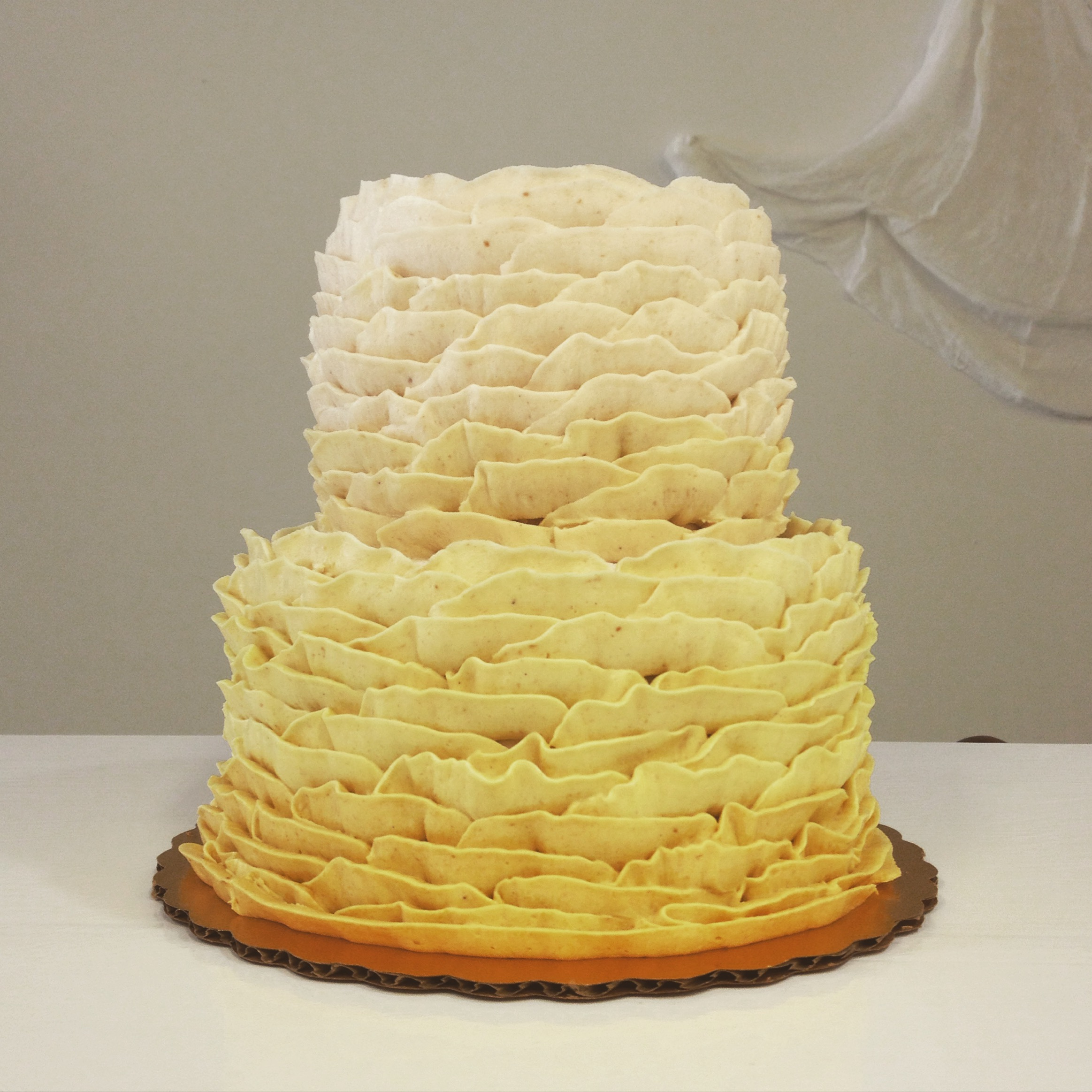 golden ombre ruffle wedding cake