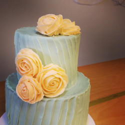 mint green wedding cake with peach buttercream roses wedding