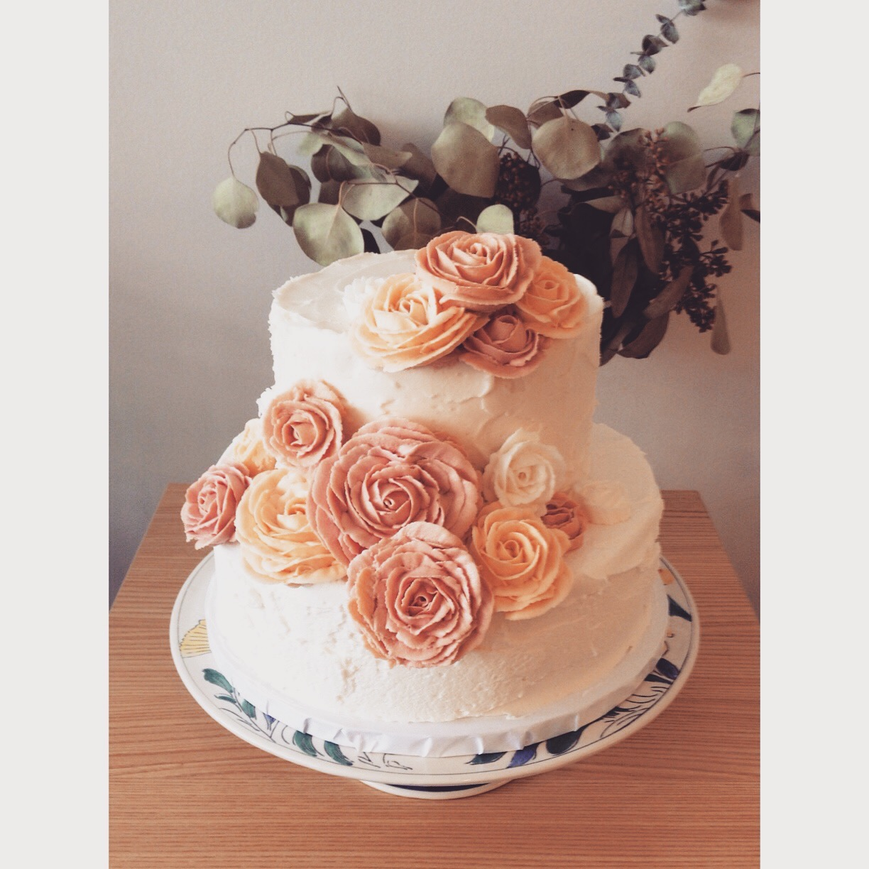 blush and pink buttercream rose wedding cake