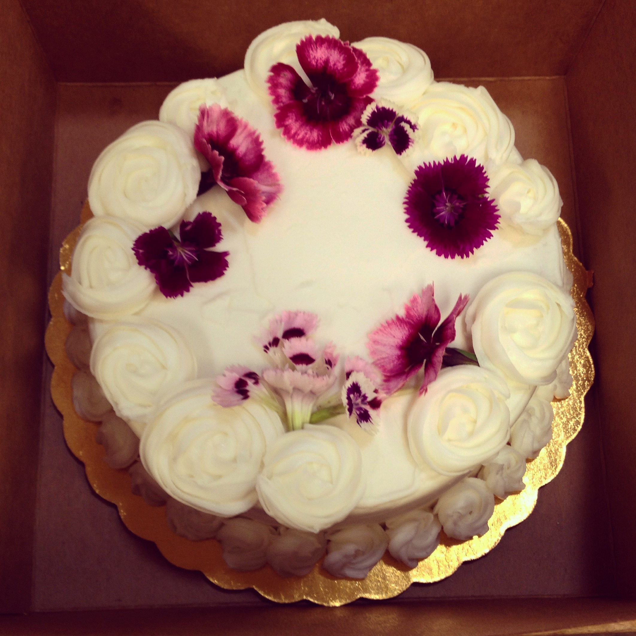 lemon blueberry cake with live edible flowers