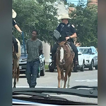 Black man led by mounted police while bound with a rope sues Texas city for $1 million
