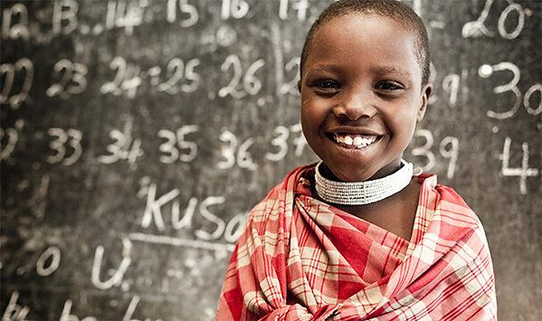 Kenyan student and chalkboard: Marshall Dance Company