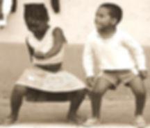 Black girl and boy dancing