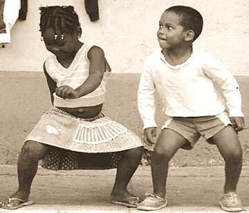 Black girl and boy dancing