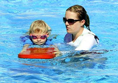 swim-lesson-kick-board-e1593983881479.jp