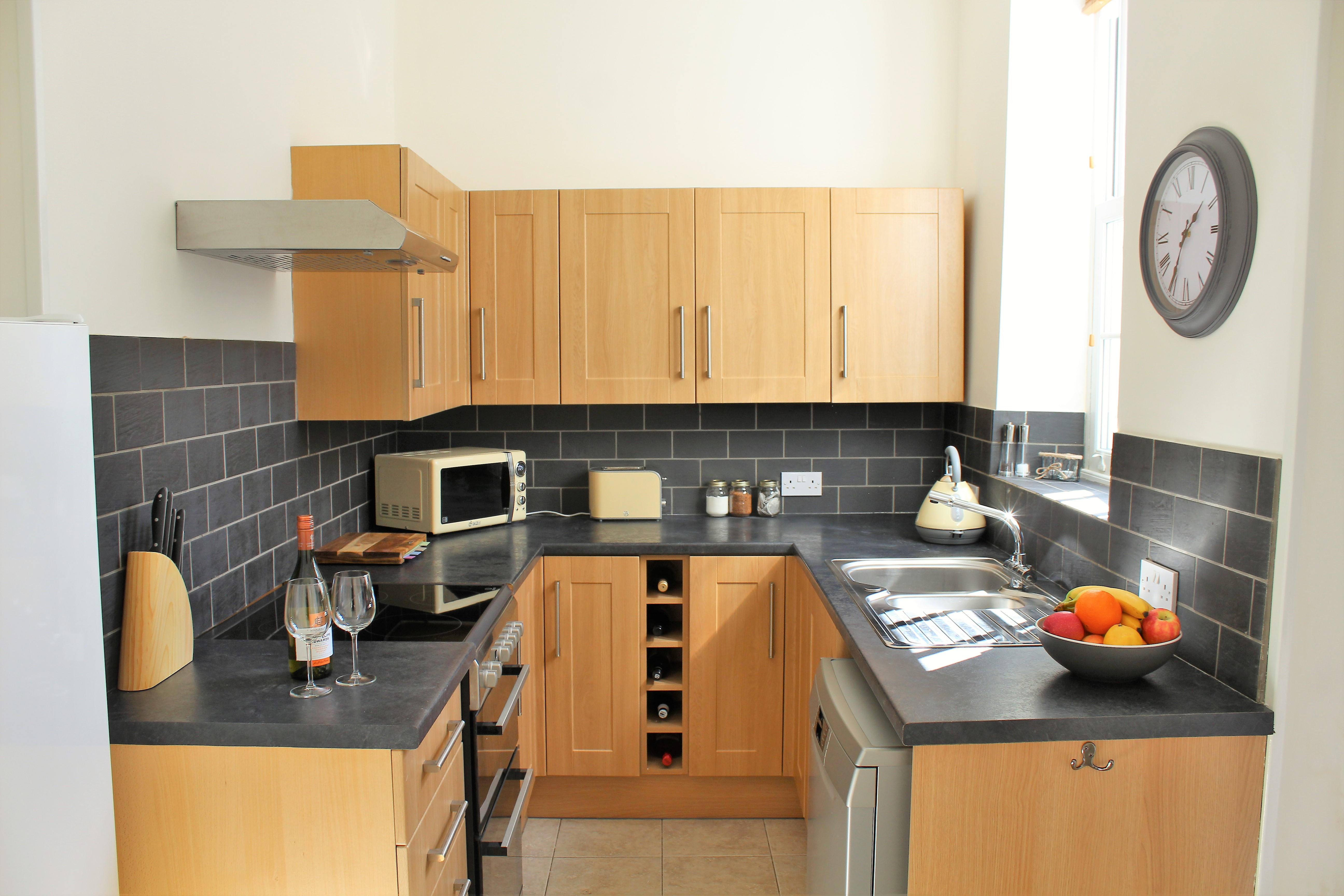 Well equipped kitchen with full size fridge freezer
