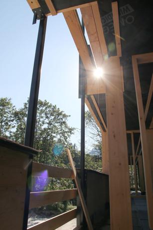 Sunlight breaking through timber balconies