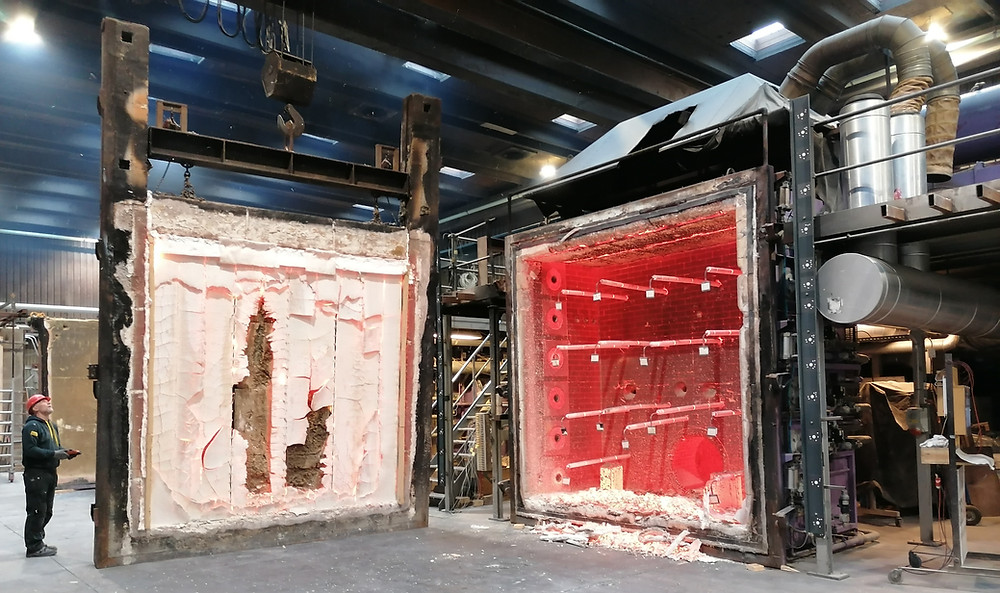 Industrial hall with test setting of 1000 degrees hot oven and insulated timber wall for fire resistance test