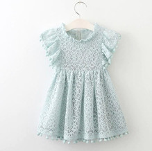 GI201051_Lace Green Dres with small pom poms on sleeves.jpg