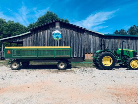 wagon in front of oaks.jpg