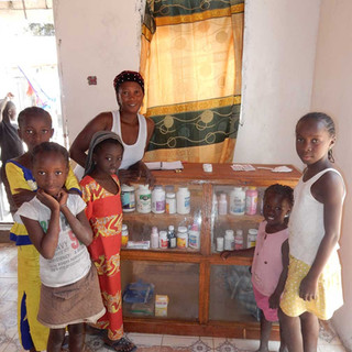 Nurse Fatou and the kids with her medicine cabinet