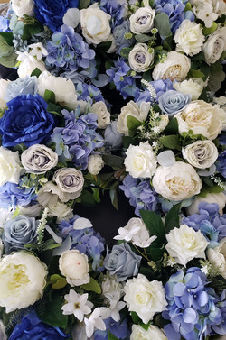 shades of blue silk floral centerpieces for a baptism