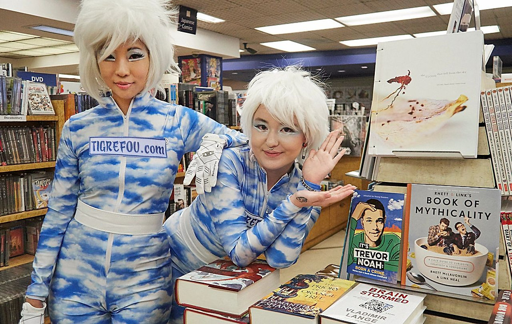 Writers Judy Choi and Phoenix Brown of Tigrefou Editions standing next to their book in Kinokuniya Los Angeles Book Store
