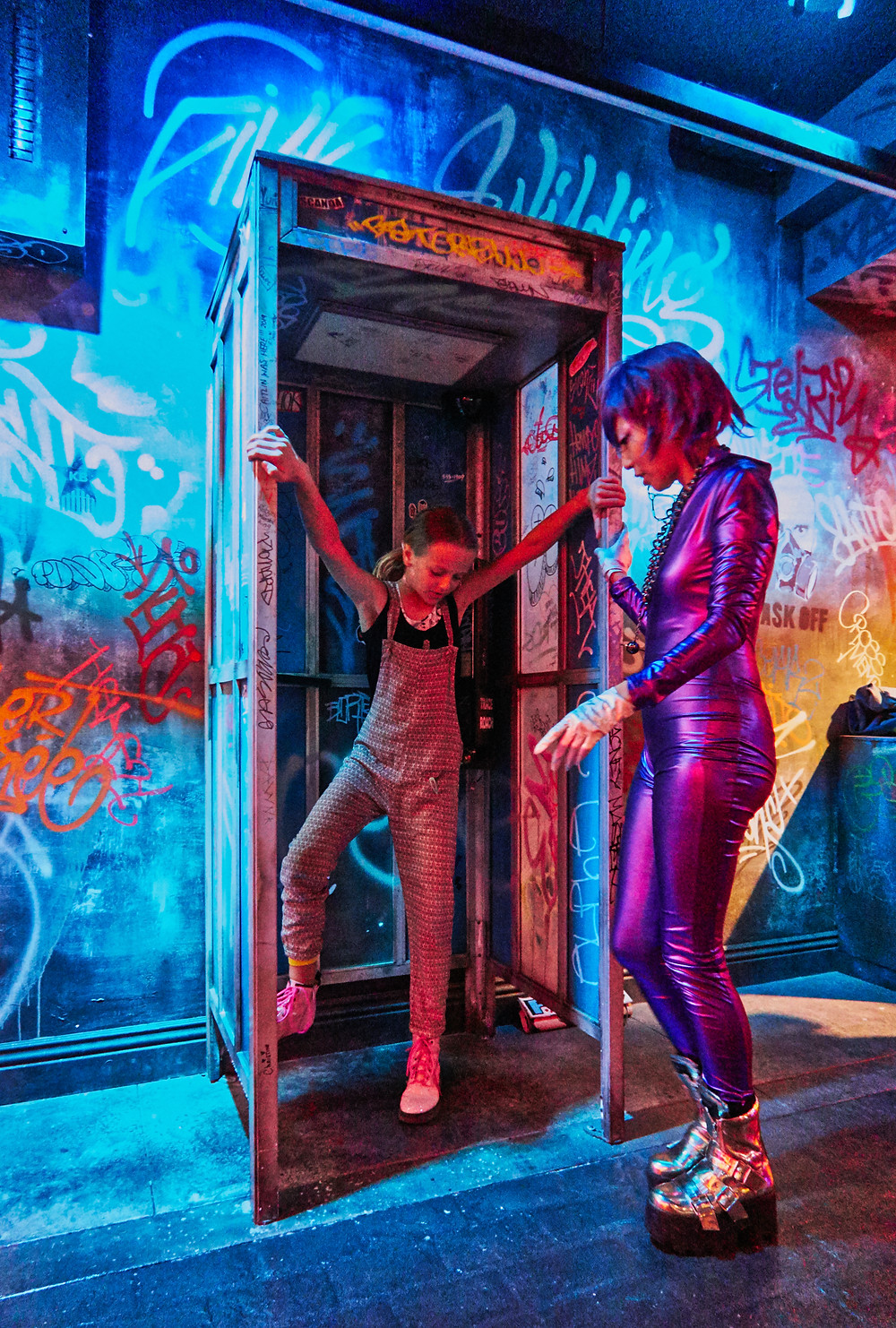 Judy Choi and Mila check out the Graffiti Phonebooth at R.U.N. Cirque du Soleil Show, photo by Francis George