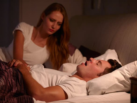 How To Sleep With A Loud Snorer