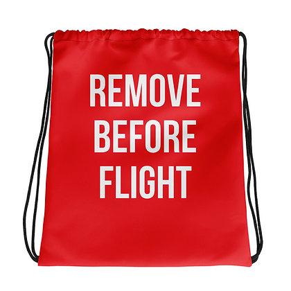 REMOVE BEFORE FLIGHT Drawstring bag