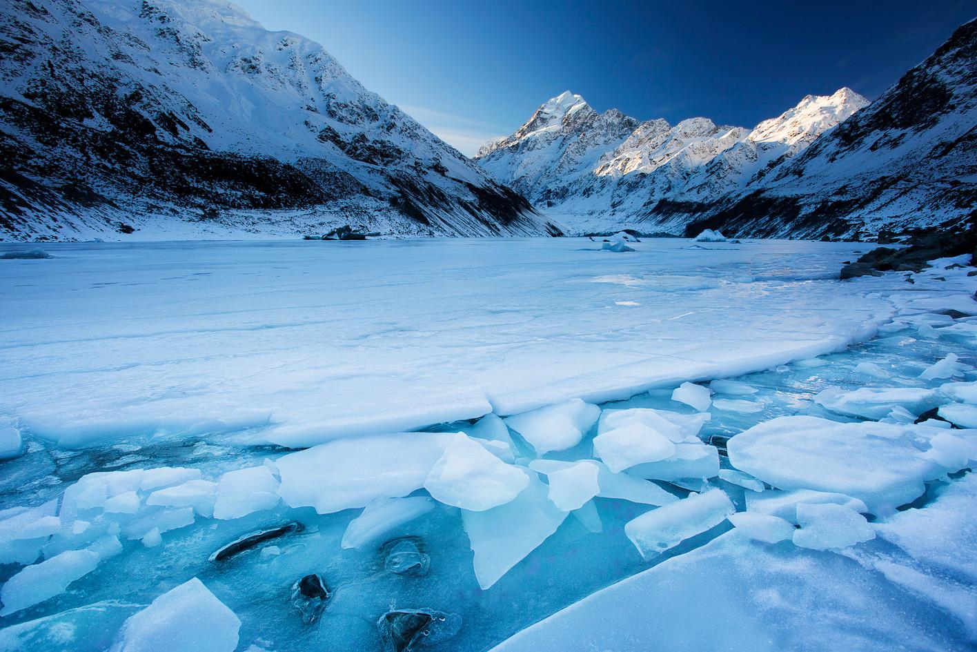 Mount Cook presides over a frozen Hooker Lake