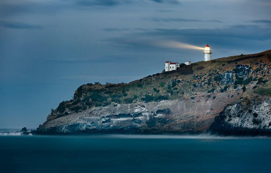 Tairoa Head lighthouse from Aramoana