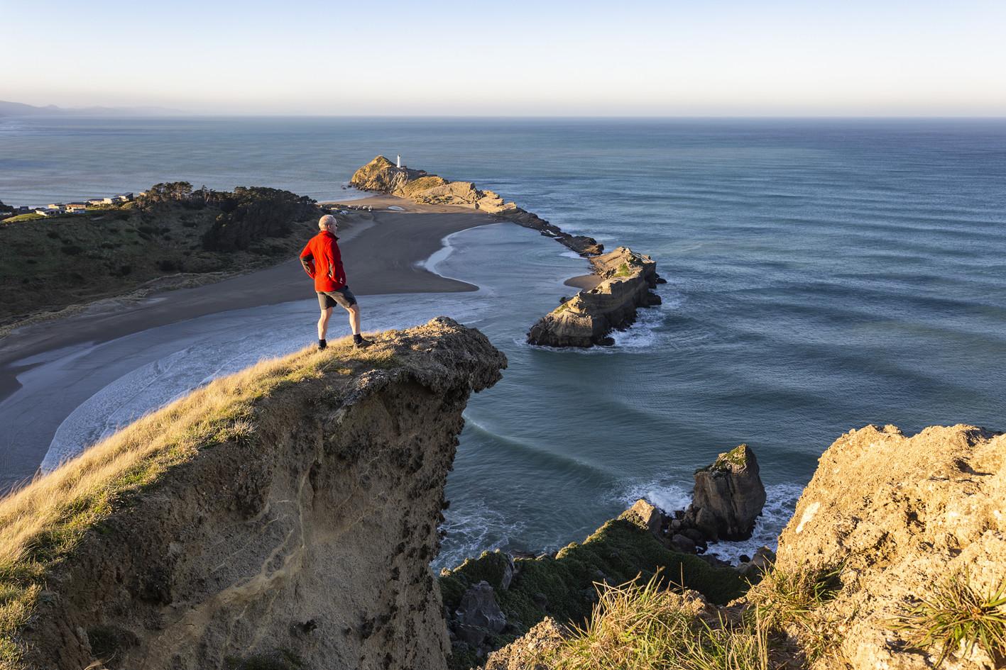 Hiker on Castle Rock, Castlepoint, Wairarapa