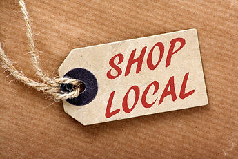The words Shop Local in red text on a br