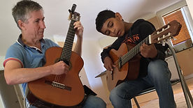 Beginner guitar lesson with teacher and student