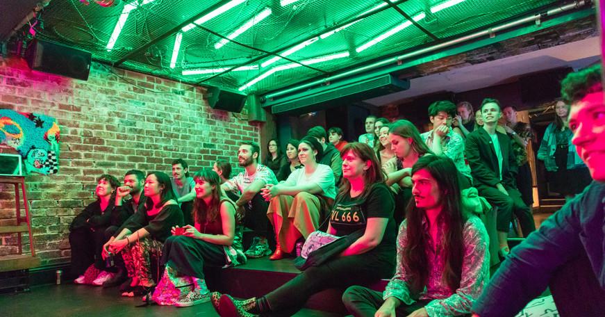 Audience members enjoying performances