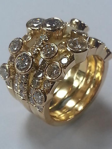 Bubble ring with 4 bands pave set and multiple brilliant cut diamonds