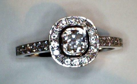 Cushion Diamond Halo with Rub over setting on Cushion