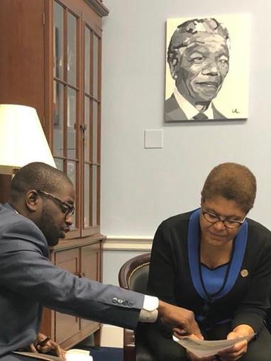 Thierry Dongala with U.S Congresswoman Karen Bass, Chair, House Africa Cmt.