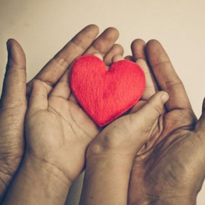 Parent-and-child-holding-a-red-heart.jpg