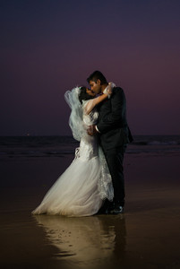 couple kissing at sunset on the beach