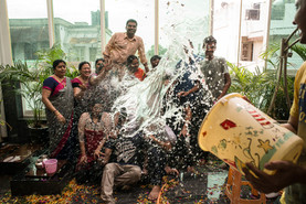 weddding group picture candid fun moment water splash