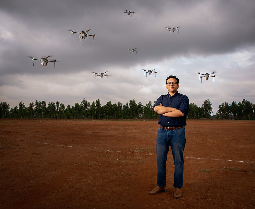 man and drones flying behind