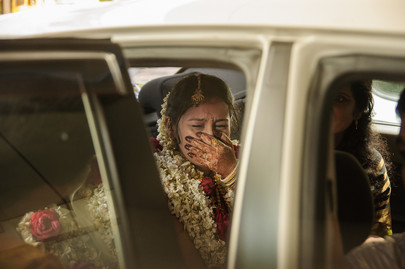 bride crying as she leaves in the car