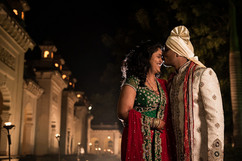 couples kissing in front of ancient indian fort