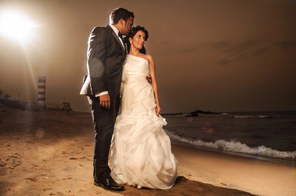 bride and groom on beach postwedding strobist lighting