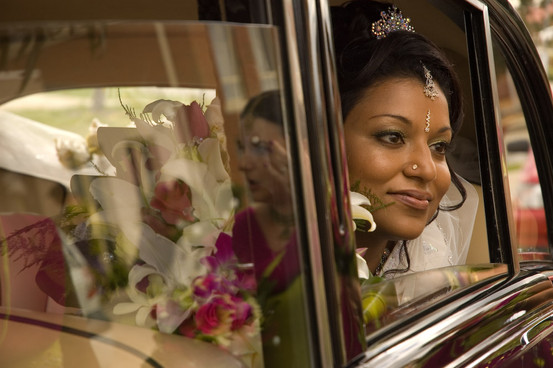 indian australian bride looks out of the car